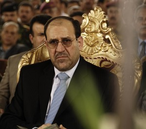 Prime Minister of Iraq Nuri al-Maliki listens to an opening speech during the Sarafiya bridge opening in Kadhimiya, Iraq